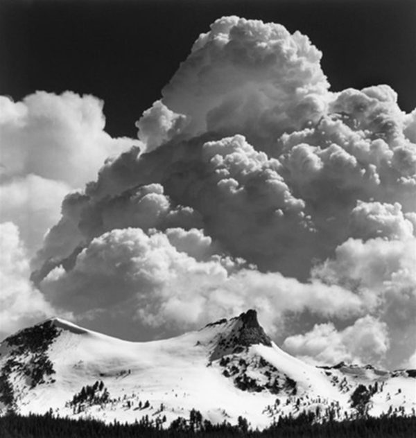 "Unicorn Peak and Thunderclouds, c. 1967, gelatin silver print, 8 x 10"" on 14 x 17"" mat ©The Ansel Adams Publishing Rights Trust"
