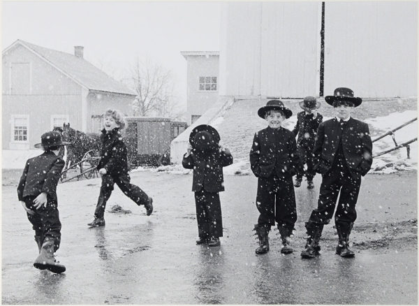 "Amish Children Playing in Snow  1969, gelatin silver print:1986, 10 x 13 1/2"" on board ©George Tice"